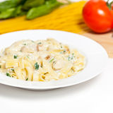 Chicken fettuccine alfredo with spinach Stock Photography