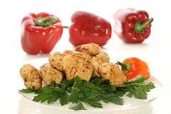 Chicken filet with coarsely ground red chili. Cut chicken filet with coarsely ground red chili Royalty Free Stock Images