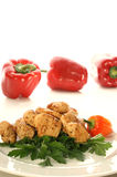 Chicken filet with coarsely ground red chili. Cut chicken filet with coarsely ground red chili Royalty Free Stock Photos
