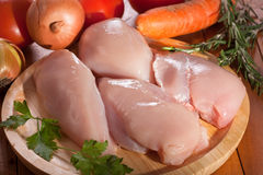 Chicken fillet. Raw chicken fillet with vegetables royalty free stock photo