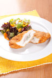 Chicken fillet with blue cheese and vegetables Stock Photos