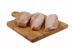 Chicken fillet on board Royalty Free Stock Photo