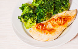 Chicken fillet with broccoli Stock Images