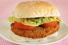Chicken fillet in a bun. With lettuce and tomato stock image