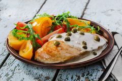 Chicken fillet with caper. Sauce Stock Photos