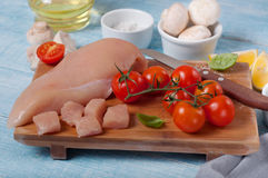 Chicken fillet with cherry tomatoes, mushrooms and basil leaves Royalty Free Stock Images