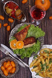 Chicken fillet in a crisp, French fries and a wine glass Royalty Free Stock Photography