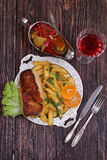 Chicken fillet in a crisp, French fries and a wine glass Royalty Free Stock Photo