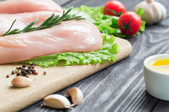 Chicken fillet on a cutting board. Stock Photos