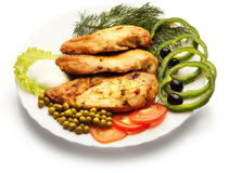 Chicken fillet decorated with pea, tomato, and paprika. Over white background Stock Photo