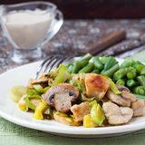 Chicken fillet fried with leek, mushrooms, green beans, cream Stock Photo