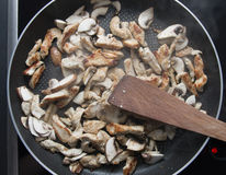Chicken fillet frying on pan with mushroom Royalty Free Stock Photo