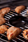 Chicken fillet on gas grill Stock Image
