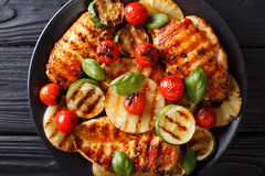 Chicken fillet grilled with pineapple and vegetables macro. hori Royalty Free Stock Image
