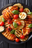Chicken fillet grilled with pineapple and vegetables macro. Vert Stock Photos