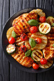 Chicken fillet grilled with pineapple, zucchini and tomatoes in Stock Photography