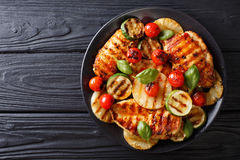 Chicken fillet grilled with vegetables in a sweet-hot sauce clos Stock Images