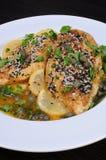 Chicken fillet in lemon-wine gravy Stock Photos