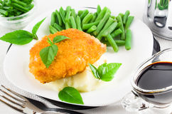 Chicken fillet, mashed potatoes and herbs Royalty Free Stock Images
