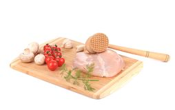 Chicken fillet and meat mallet. Royalty Free Stock Image