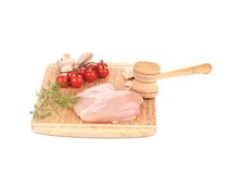 Chicken fillet and meat mallet. Stock Photo