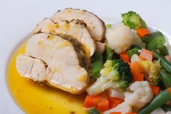 Chicken fillet with a mix of vegetables macro Royalty Free Stock Photo