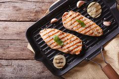 Chicken fillet with onion in a pan grill. horizontal top view Stock Image