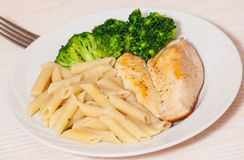 Chicken fillet with penne pasta and broccoli Royalty Free Stock Images