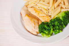 Chicken fillet with penne pasta and broccoli Stock Images