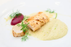 Chicken fillet with potato and beetroot puree Stock Photo
