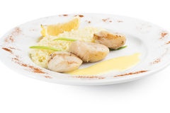 Chicken fillet with rice. And lemon sauce Stock Images