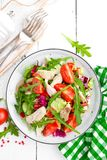 Chicken fillet salad with tomato, lettuce, cucumber and arugula leaves. Fresh vegetable salad with chicken meat. Healthy food. Whi. Te wooden background. Top Royalty Free Stock Photos