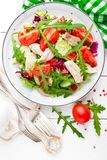 Chicken fillet salad with tomato, lettuce, cucumber and arugula leaves. Fresh vegetable salad with chicken meat. Healthy food. Whi. Te wooden background. Top Stock Photos