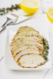 Chicken fillet slices with thyme. On a white plate Stock Photo