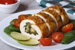 Chicken fillet stuffed with spinach and cheese closeup Royalty Free Stock Photo