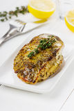 Chicken fillet with thyme. On a white plate Stock Photo
