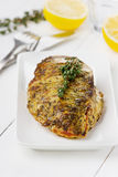 Chicken fillet with thyme and lemon. Chicken fillet with thyme on a white plate Royalty Free Stock Photos