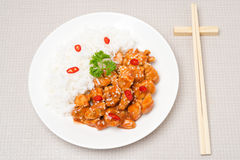 Chicken fillet in tomato sauce with sesame seeds, rice, top view Stock Photography