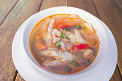 Chicken finger spicy soup. On wood table Royalty Free Stock Image