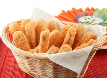 Chicken fingers. Basket of crispy chicken fingers with platter of vegetables and dip Royalty Free Stock Photo