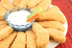 Chicken fingers. Plate of crispy chicken fingers with  vegetables and dip Stock Photos