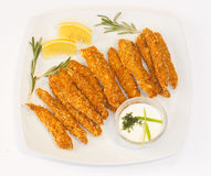 Chicken fingers. Plate of crispy chicken fingers and dip on white background Royalty Free Stock Photos