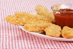 Chicken fingers focus on bowl Stock Photo