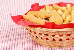 Chicken fingers and french fries in a basket Stock Photos