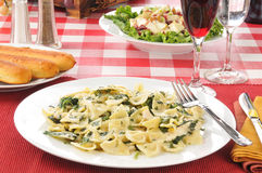 Chicken Florentine and Farfalle. With spinach in a parmesan cheese sauce stock images