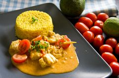 Chicken food with rice, paprika, tomatoes Stock Photo