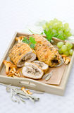 Chicken forest. Chicken roulade with mushrooms and grapes Royalty Free Stock Photography
