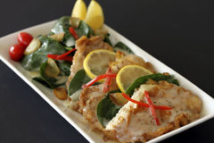 Chicken francaise on white dish. Royalty Free Stock Photo