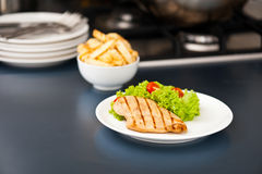 Chicken, French fries and salad Royalty Free Stock Photo