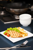 Chicken, French fries and salad Royalty Free Stock Images